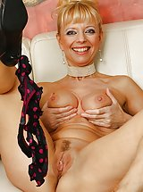 Tall mature babe Marylin toys her tight older pussy